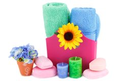 Spa set. With towels, soaps, candles and flowers isolated on white background Stock Photography