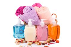 Spa set. With towels, liquid soaps and dried flower isolated on white background Stock Images