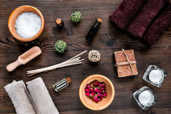 Spa set with towels and soap on wooden background top view Royalty Free Stock Images