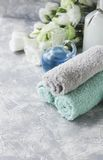 Spa set on a white marble table with a stack of towels, selective focus Stock Photography