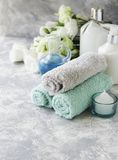 Spa set on a white marble table with a stack of towels, selective focus Royalty Free Stock Photography