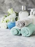 Spa set on a white marble table with a stack of towels, selective focus Royalty Free Stock Photos