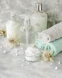 Spa set on a white marble table with a stack of towels, selective focus Stock Photos
