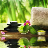 Spa setting. With Massage stones and soft towel Royalty Free Stock Photos