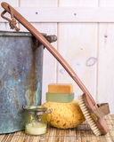Spa setting. A spa still life with soap, back brush candle sponge, sponge, candle, old wash tub and bamboo mat Stock Photography