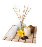Spa setting. With aroma sticks, candle, flower, towel, wooden ball and rocks isolated on white background Royalty Free Stock Photography