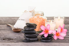 Spa setting with bath salt, stones and flowers Stock Photo