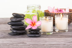 Spa setting with bath salt, stones and flowers close-up Stock Image
