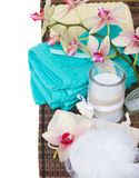 Spa setting with blue towels and bath accessories Stock Images