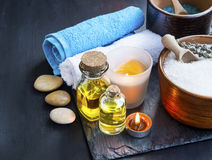 Spa setting with body oils, towels ,bath salt and candles Royalty Free Stock Images