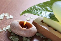 Spa setting with burning candle Royalty Free Stock Photos