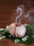 Spa setting with burning candle Royalty Free Stock Photography