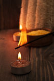 Spa setting with candle and aroma stick on wooden background Royalty Free Stock Image