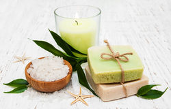 Spa setting with candle, handmade soap and salt Royalty Free Stock Photo