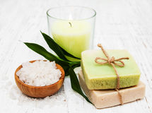Spa setting with candle, handmade soap and salt Royalty Free Stock Photography