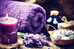 Spa setting with candle and lavender flowers Stock Photos