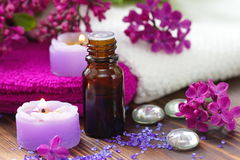 SPA setting with candles, aroma oil and lilac. Flowers Stock Photography