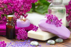 SPA setting with candles, aroma oil and lilac Stock Photo