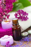 SPA setting with candles, aroma oil and lilac Stock Images