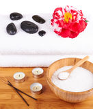 Spa setting with candles, flower, towel and stones Royalty Free Stock Photos