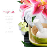 Spa setting with candles and pink lily Royalty Free Stock Photos