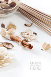 Spa setting with cinnamon on a white background Royalty Free Stock Photos