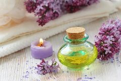 SPA setting. Essential aroma oil with lilac Royalty Free Stock Photography