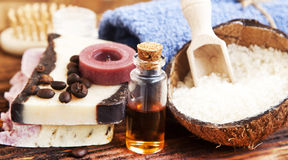 Spa Setting with Essential Oil Bottle, Natural Soap and Sea Salt Stock Photos