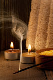 Spa setting and fuming aroma stick on wooden background Stock Photography