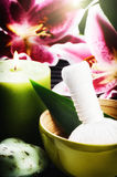 Spa setting with herbal ball, candle and lily Stock Image