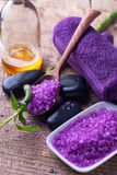 Spa setting. Lavender sea salt, bottle with aroma oil and towels Royalty Free Stock Image