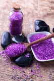 Spa setting. Lavender sea salt and stones on aged  wooden backgr Royalty Free Stock Photo