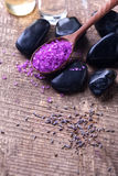 Spa setting. Lavender sea salt and stones on aged  wooden backgr Royalty Free Stock Photography