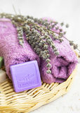 Spa setting with lavender soap,flowers and towels Royalty Free Stock Images