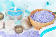 Spa setting. With lilac bath salts and a burning candle royalty free stock photography