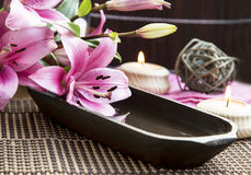 Spa Setting with Lilies and Water Wooden Bowl Royalty Free Stock Images
