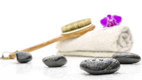 Spa setting with massage stones, brush and a towel Stock Photo