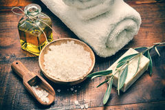 Spa setting with natural olive soap and sea salt. On wooden table Stock Images