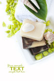 Spa setting with natural soaps and shampoo Stock Photos