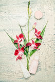 Spa setting with orchid flowers and cosmetic on withe shabby chic background. Wellness composing Stock Photos