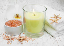 Spa setting with orchid, towels, candle and salt Royalty Free Stock Images