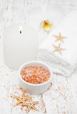 Spa setting with orchid, towels, candle and salt Royalty Free Stock Image