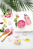 Spa setting with pink roses and aroma oil, vintage style Royalty Free Stock Photo