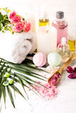 Spa setting with pink roses and aroma oil, vintage style Royalty Free Stock Image