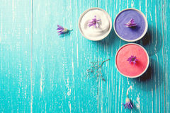 Spa setting with purple flower on blue wooden background Stock Photos