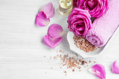 Spa setting with roses, bath salt and body-oil Stock Image