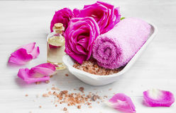 Spa setting with roses ,bath salt and oil, cotton towel Royalty Free Stock Photo