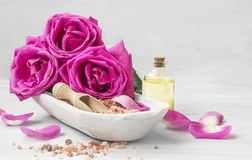 Spa setting with roses, bath salt and oil Royalty Free Stock Photography