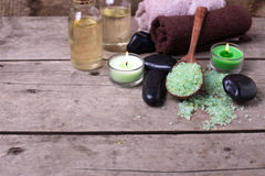 Spa setting. Sea salt, candles, bootle with aroma oil and towels Royalty Free Stock Photo