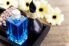 Spa setting shape and sea salt spa. Aromatherapy oil with sea salt and gerbera flower for spa Royalty Free Stock Images